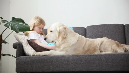 Video Stock Di Care For Pets Blonde Girl Is Reading A Book Lying