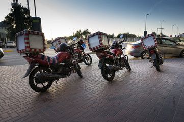 Pizza delivery motorcycles parked on the street waiting for the order and delivery to the client