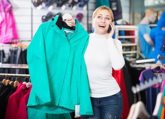 Girl picking a warm jacket