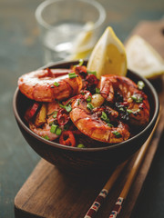 Large grilled BBQ shrimp with sweet chili sauce, green onion and lemon. Toned image