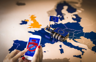 Female hands using a smartphone with geoblocking on screen and Padlock over EU map. European Union Digital single market and regulation against Geo-blocking and geographically-based restrictions