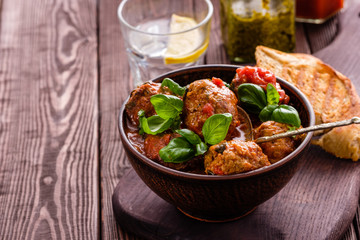 Delicious homemade meat balls in tomato sauce.