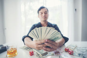 Man holding a lot of Money in hand , Business Success Concept.