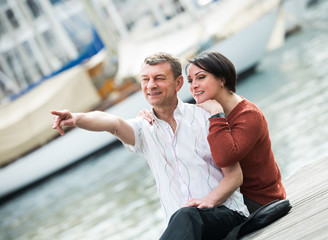 Positive couple in love posing outdoors together
