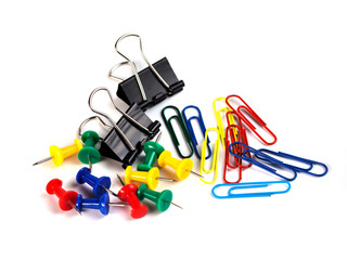 Scissor, tacks and paper clips on white background