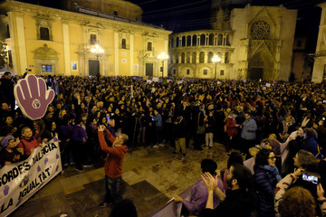 People gather at the Virgin Square during a demonstration as part of a nationwide feminist strike on International Women's Day in Valencia