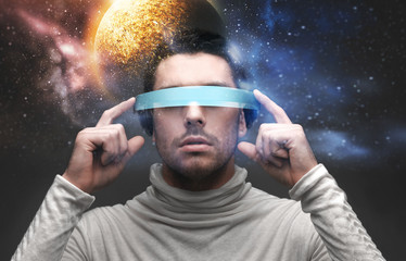 man in 3d glasses over space background