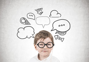 Cute little boy with glasses, thought bubbles