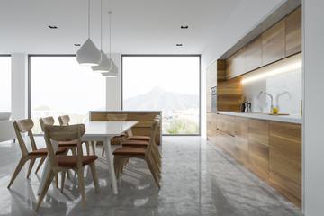 Panoramic kitchen interior, white table