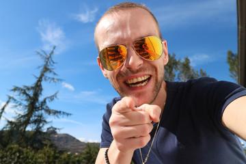 Happy man in nature making selfie