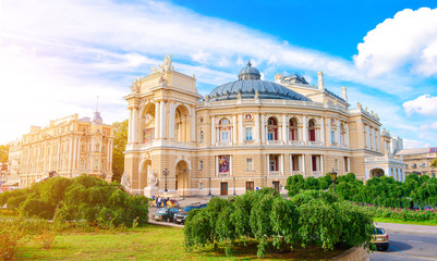 Deurstickers Theater Opera and Ballet Theatre. Odessa theater. Vocal art. Old architecture. Sun glare. Blue cloudly sky.