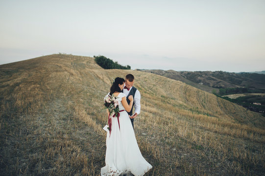Young couple kissing in Tuscany, Italy
