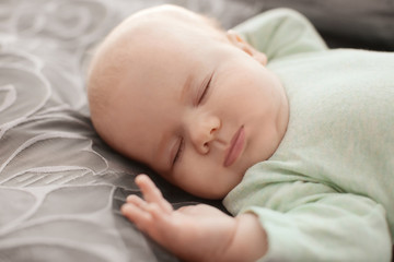 Cute little baby sleeping on bed
