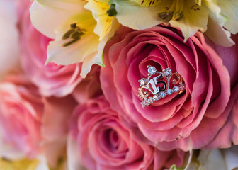 flower bouquet and quinceanera ring