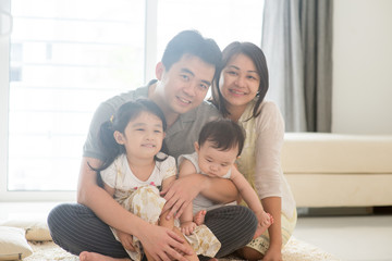 Portait of Asian family at home
