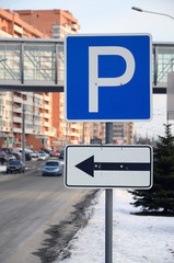 Parking left. Traffic sign with the letter P and the arrows to the left