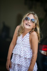 Sill Girl in Garage with Sunglasses Making Faces