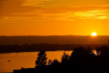 Sunset over a fisherman on the Columbia river.