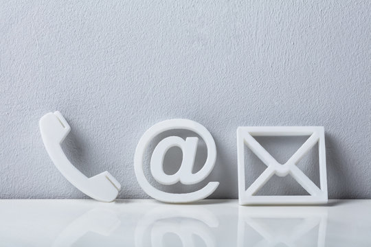 Close-up Of A Phone, Email and Post Icons