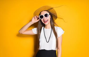 happy woman in a hat wearing glasses, rest