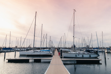 Floating pier with moored sailing yachts