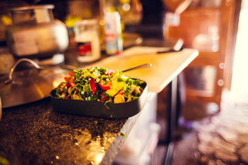 Salad on the kitchen table.
