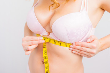 Woman measuring chest base size for perfect bra fit