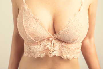 Woman wearing lace bra, retro vintage photo filter