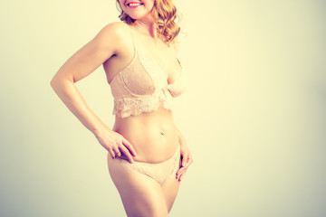 Woman posing in lace underwear, vintage effect photo filter