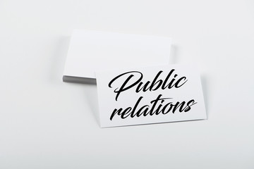 Business card concept with the words Public relations. Isolated. Mockup.