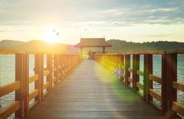 A wooden boat dock at the beautiful sunset