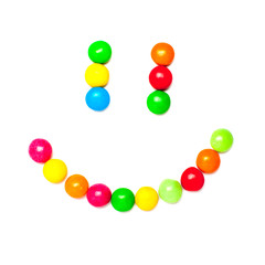 Smiley face made of colorful candies isolated on white background