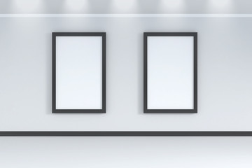 Two empty white frames on the white wall room with spot light above  - 3d rendering
