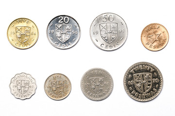 Ghanaian coins on a white background