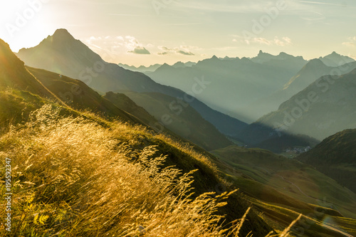 Fototapete Beautiful sunrise and layered mountain silhouettes in early morning. Lechtal and Allgau Alps, Bavaria and Austria.