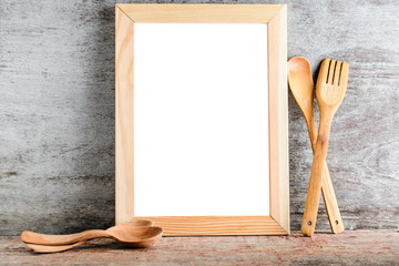empty wooden frame and kitchen accessories.