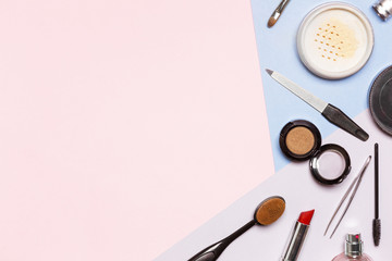 lay flat with various cosmetics on a blue background. A lot of free space for your text. the picture on the price for the makeup artist or beauty salon