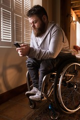 Disabled man using mobile phone