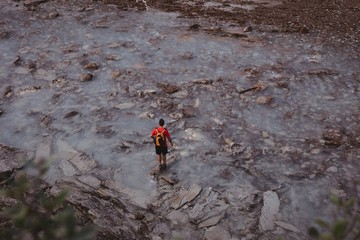 Overhead view of man standing on stream