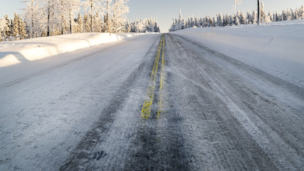 Close up of icy road in winter.