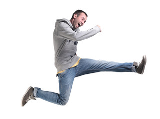 Portrait of an excited young man jumping in air against