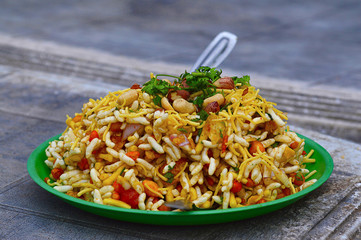 Bhelpuri is a savoury snack or chaat. It is made out of puffed rice, vegetables, tangy tamarind sauce