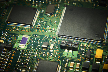 Electronic computer circuit board close up.