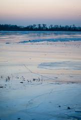 Frozen Odra river at dusk