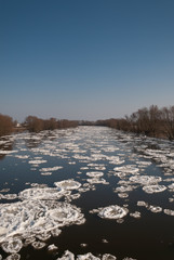 Warta river covered with floe