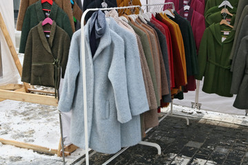 Old unfashionable coats and jackets are distributed free of charge