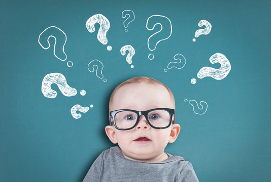 Thinking baby with question marks on background