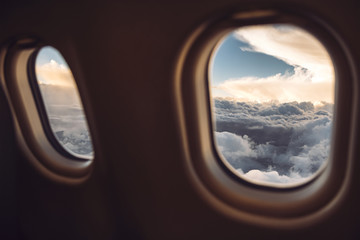Close-up of airplane window during sunset