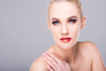 Portrait of sexy young blonde woman wearing make-up.
