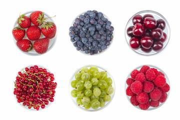 Berries on Isolated white background, bowl of Cherry, currant, blueberries, gooseberries, raspberries, blackberries, strawberries.